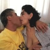 Mature Arab couple having sex in their bedroom.